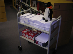 Puron on a book cart