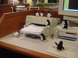 Penguins by a printer